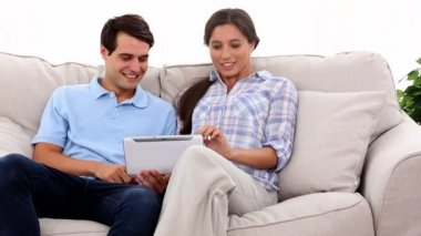 Young couple using tablet — Stock Video