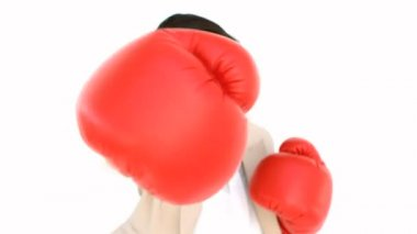 Businesswoman boxing at the camera — Stock Video