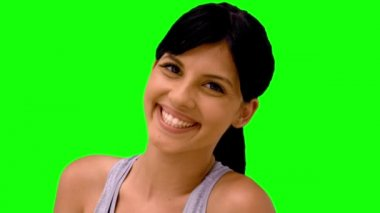 Athletic woman smiling at camera on green screen — Stock Video