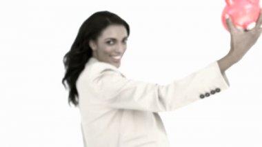 Businesswoman holding piggy bank — Stock Video