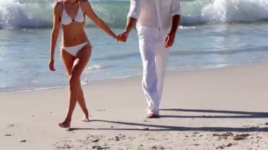 Attractive couple walking hand in hand — Stock Video