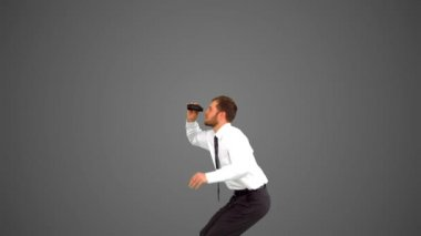 Businessman leaping and holding tablet on grey background — Stock Video