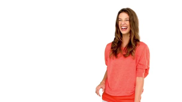 Smiling woman catching a basket ball on white background — Vidéo