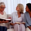Retired friends studying the bible together — Stock Video #25690141