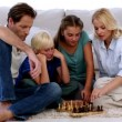 Children and parents playing chess — Stock Video #25690347
