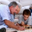 Stock Video: Extended family playing chess together