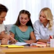 Parents proud of their daughters homework — Stock Video #25690749