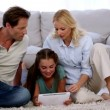 Parents and daughter using tablet on floor — Stock Video #25691031