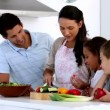 Stock Video: Mother showing children how to chop vegetables