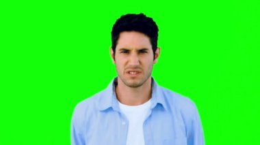 Man growling at camera angrily on green screen — Stock Video