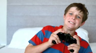 Concentrated young boy playing video games — Stock Video