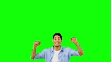 Man jumping for joy on green screen — Stock Video