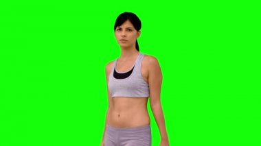 Athletic woman making marital arts pose on green screen — Stock Video
