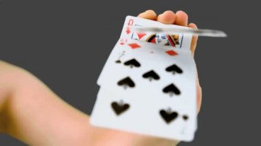 Hand shuffling and pushing cards towards the camera — Stock Video