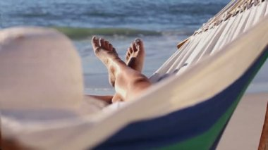 Woman relaxing on the beach in a hammock — Stock Video
