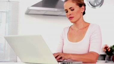 Woman using laptop at home — Stock Video