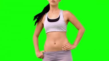 Athletic woman tossing hair on green screen — Stock Video