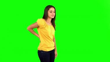 Woman rubbing painful back on green screen — Vídeo Stock