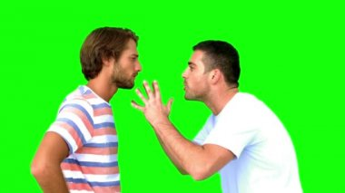 Man about to fight another man on green screen — Stockvideo