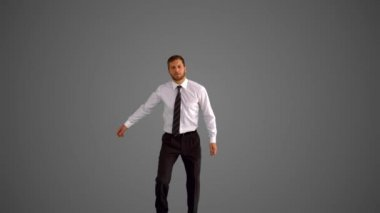 Businessman jumping and clicking heels on grey background — Stock Video