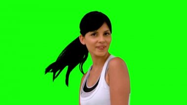 Athletic woman tossing her hair on green screen — Stock Video