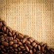 Burlap sack and pile of coffee beans - Stock Photo