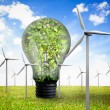 Wind turbines and bulb full of leaves — Stock Photo #25717673