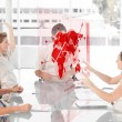 Cheerful business workers using red map diagram interface — Stock Photo