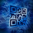 Qr code standing in front of circuit board — Stock Photo