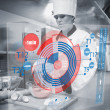 Pastry chef making dough while consulting futuristic interface — Stock Photo
