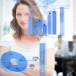 Confident businesswoman using chart interfaces — Stock Photo