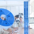Serious business using blue pie chart interface — Stock Photo