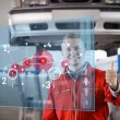Stock Photo: Portrait of smiling mechanic showing thumbs up with futurist int