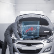 Stock Photo: Mrepairing car with open hood and futuristic interface
