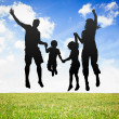 Silhouette of jumping family — Stock Photo