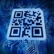 Stock Photo: Qr code standing in front of futuristic background