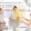 Cheerful business workers using yellow pie chart interface — Stock Photo #25718717