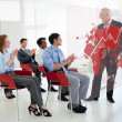 Business clapping stakeholder standing in front of red ma — Stockfoto