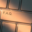 Keyboard with close up on Frequently Asked Question button — Stockfoto
