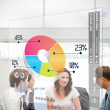 Business workers using colorful pie chart interface — Stock Photo