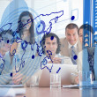 Smiling business workers looking at blue map interface — Stock Photo