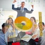 Cheerful business using yellow pie chart interface — Stock Photo #25719429