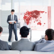 Business listening and looking at red map diagram interfa — Foto Stock