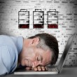 Businessman sleeping on his laptop with no battery symbols — Stock Photo