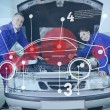 Stock Photo: Two happy mechanics consulting futuristic interface with open ho