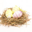 Three easter eggs in straw — Stock Photo #25719937