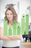 Confident blonde businesswoman using green chart interface — Stock Photo