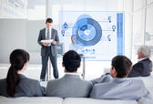 Business listening and looking at blue diagram interface — Stock Photo