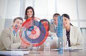 Smiling business workers looking at chart interface — Stock Photo