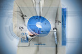 Businessman using blue pie chart interface — Stock Photo